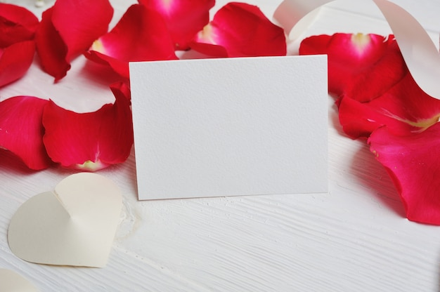 Flowers composition heart letter with red rose petals Premium Photo