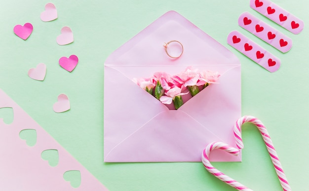 Flowers in envelope with wedding ring Free Photo