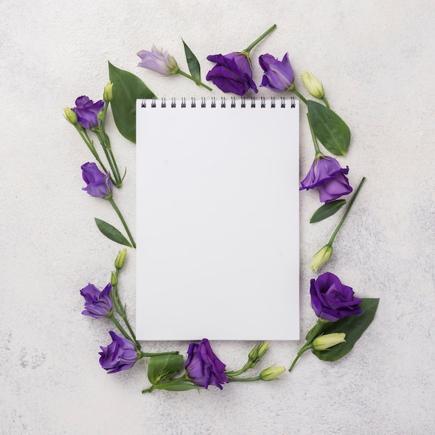Flowers frame with notebook Free Photo