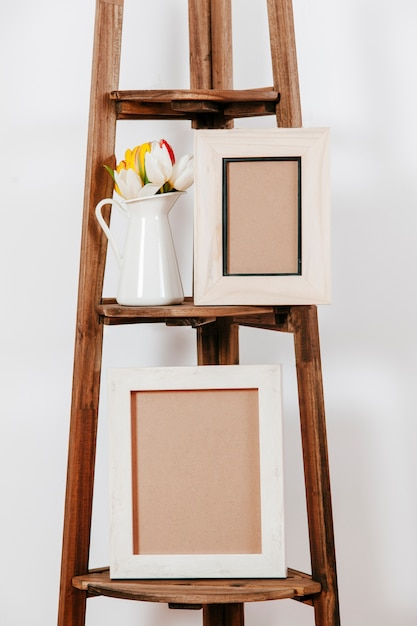 Flowers stand with photo frames Free Photo