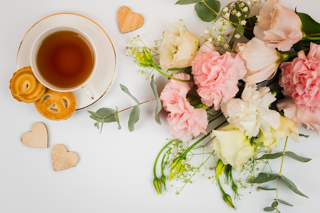 Flowers and tea in flat lay Free Photo
