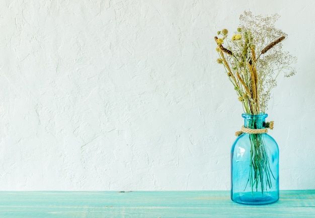 Flowers in a vase on the table. Premium Photo