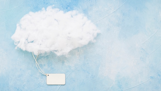 Fluffy cloud on blue surface Free Photo
