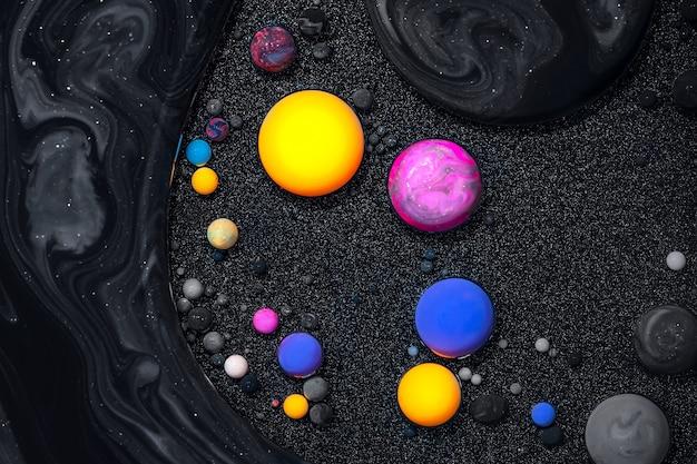 Жидкая художественная текстура. фон с абстрактным эффектом закрученной краски. картина жидким акрилом смешанными красками и пузырьками. Premium Фотографии