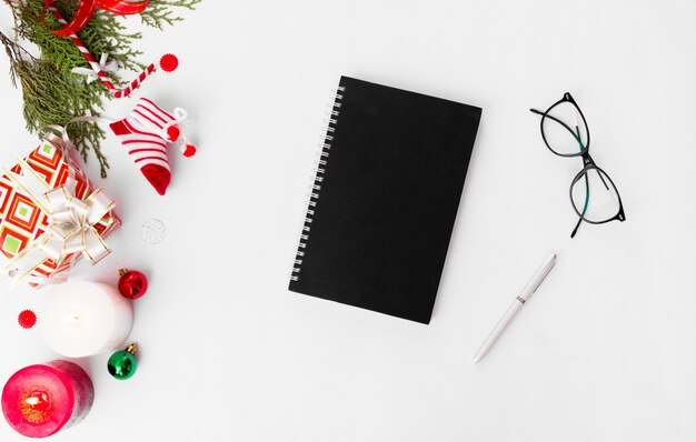 Flyer diary christmas, fir branches pine cones candle flat lay
