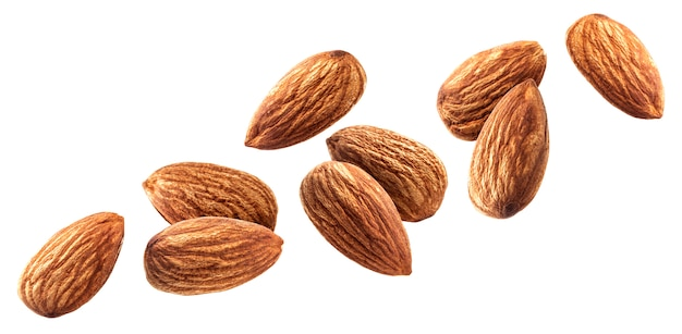 Flying almond isolated on white background with clipping path Premium Photo