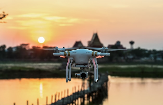 A flying drone armed with camera Premium Photo