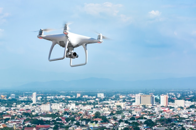 Flying drone above town Premium Photo