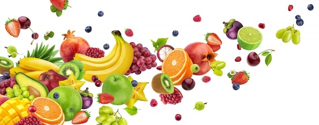 Flying fruits and berries isolated on white Premium Photo