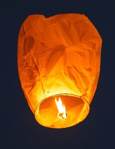 Flying lantern in the dark sky Premium Photo