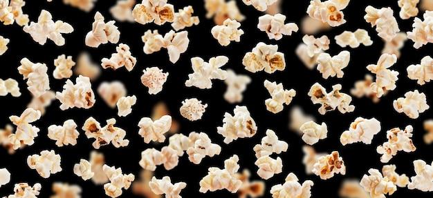 Flying popcorn isolated on black Premium Photo