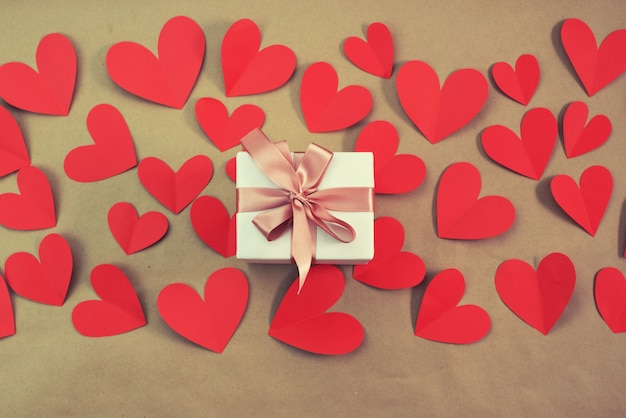 Flying red hearts concept of valentines day top view flat lay Premium Photo