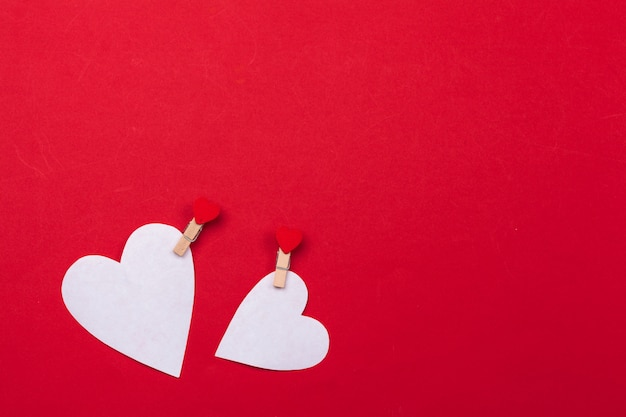 Flying red paper hearts background Premium Photo