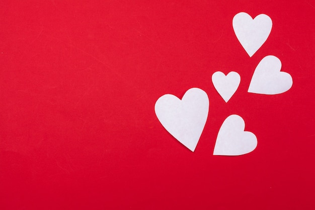 Flying red paper hearts. valentine's day. heart shape. copy space background Premium Photo