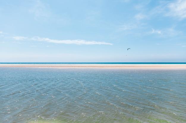 Flying with parachute on exotic seashore Free Photo