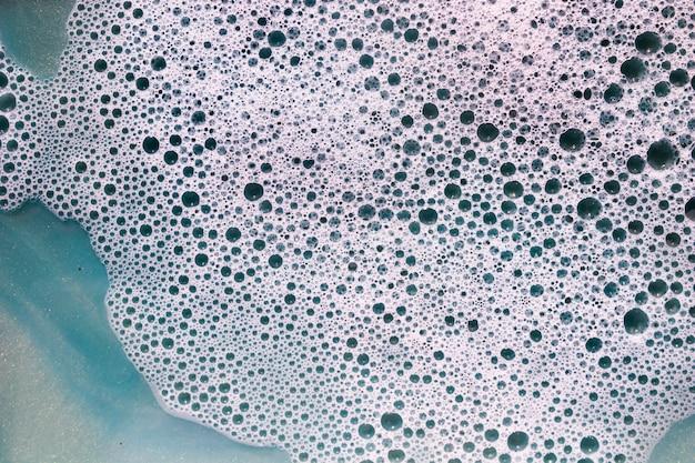 Foam and blobs on black liquid Free Photo