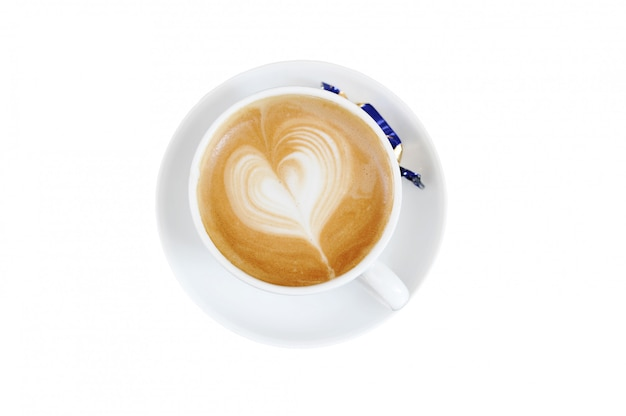 Foam on cappuccino in the form of a heart Premium Photo