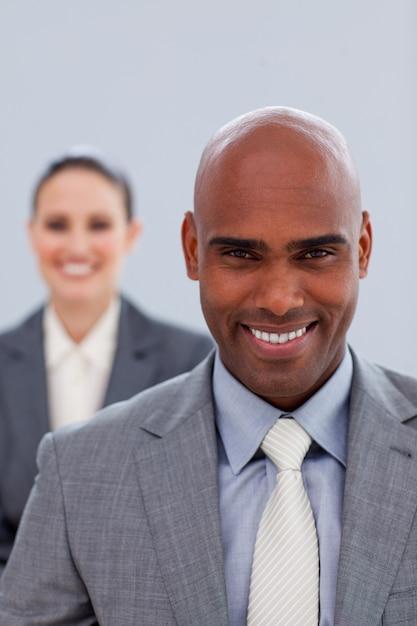 Focus on an attractive businessman smiling Premium Photo