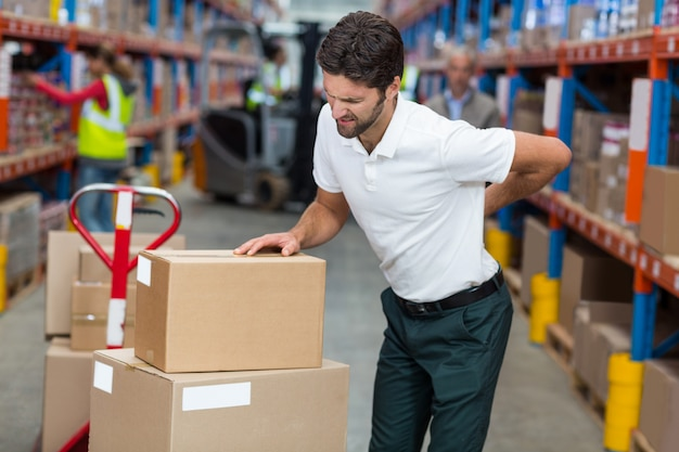 Focus of worker having a backache Premium Photo