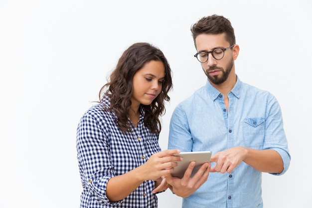 Focused couple with tablet analyzing family budget Free Photo