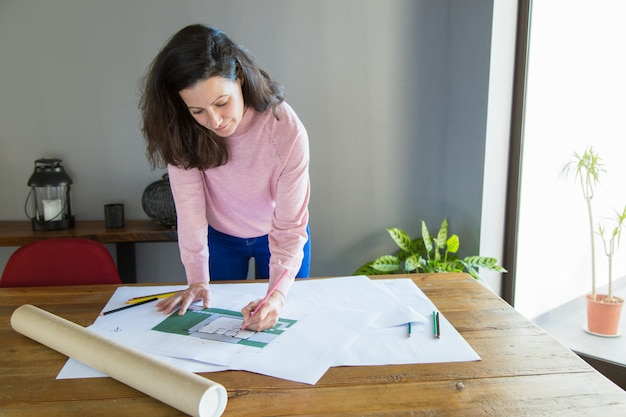 Focused professional working on apartment design project Free Photo