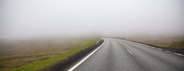 Foggy road. dangerous and mystical foggy highway Premium Photo