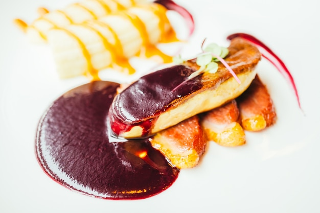 Foie gras and duck meat with sweet sauce Free Photo