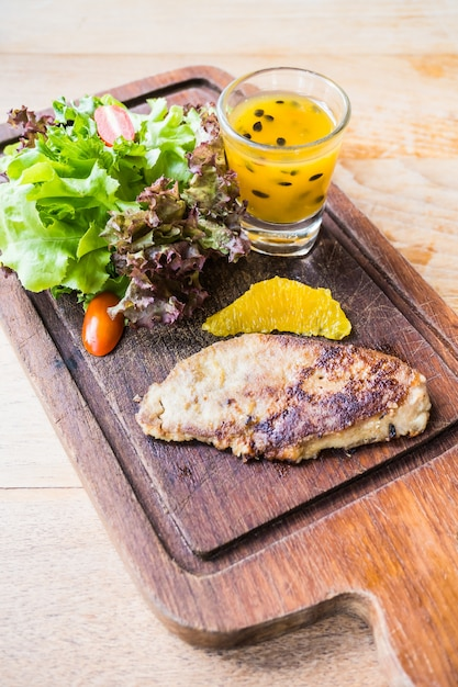 Foie gras steak with vegetable and sweet sauce Free Photo