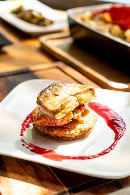 Foie gras with lobster and raspberry sauce Premium Photo
