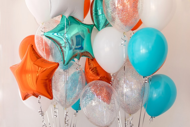 Foil star colored balloons close up Premium Photo