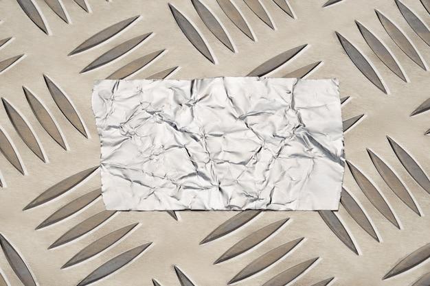 Foil tape sticker on anti slip aluminum metal plate with diamond pattern Premium Photo