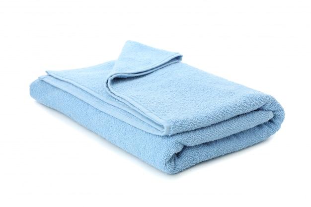 Folded blue towel isolated on white background, close up Premium Photo