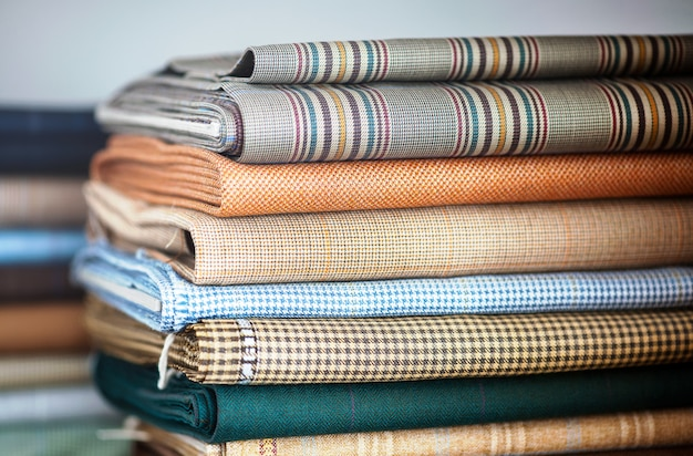 Folded fabrics in a neat stack Premium Photo