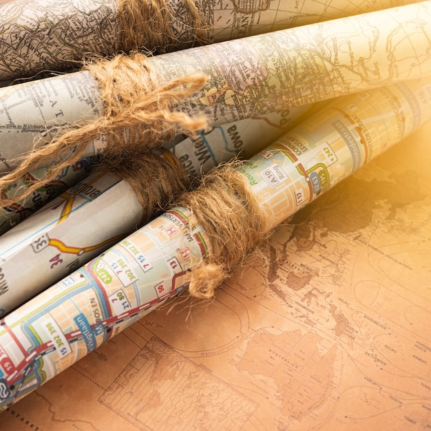 Folded maps on an old map background Free Photo