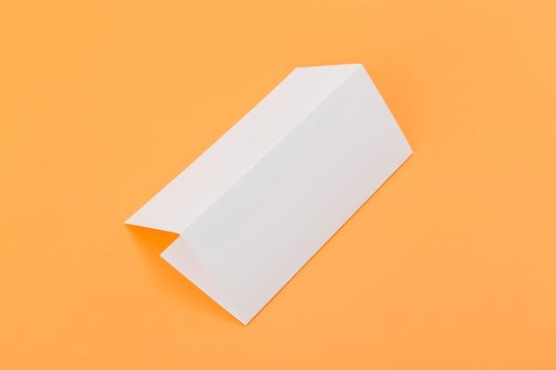 Folded rectangle brochure on desk Free Photo