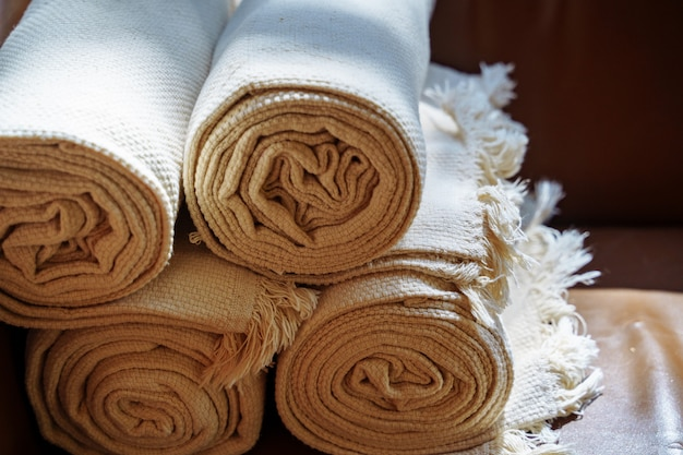 Folded spa towels in the bathroom or hotel Premium Photo