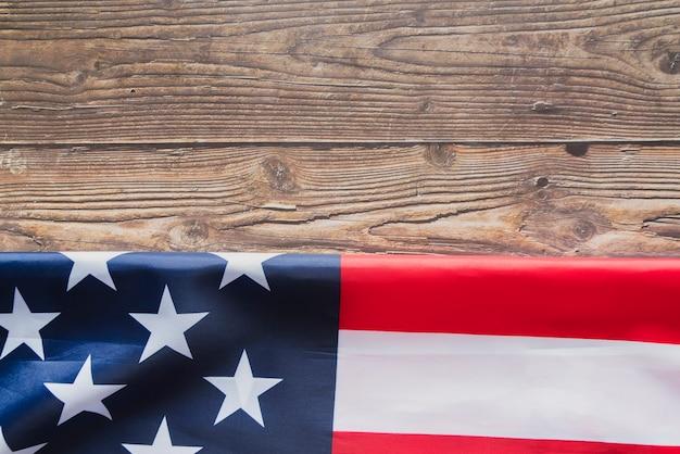 Folded united states flag on timber Free Photo