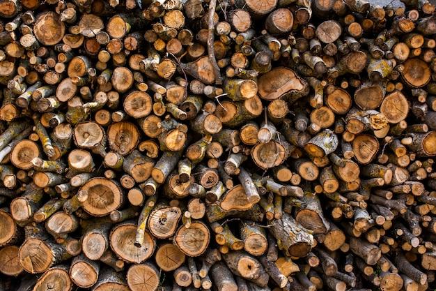 Folded wooden logs. Premium Photo