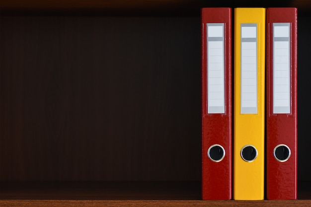 Folders for documents in the closet on the shelf in the office Premium Photo