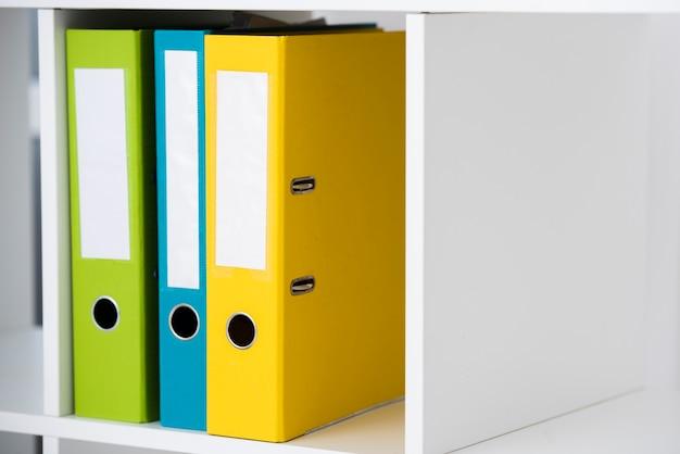 Folders in the shelf Free Photo