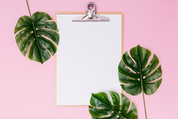 Foliage arrangement and blank clipboard Free Photo