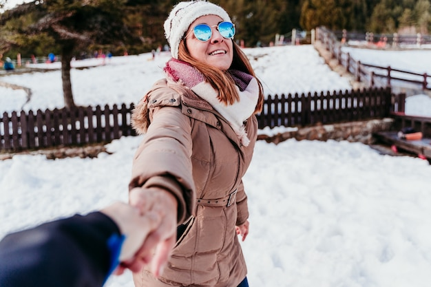 Follow me. happy woman and man holding hands. pov. at the mountain. love concept Premium Photo