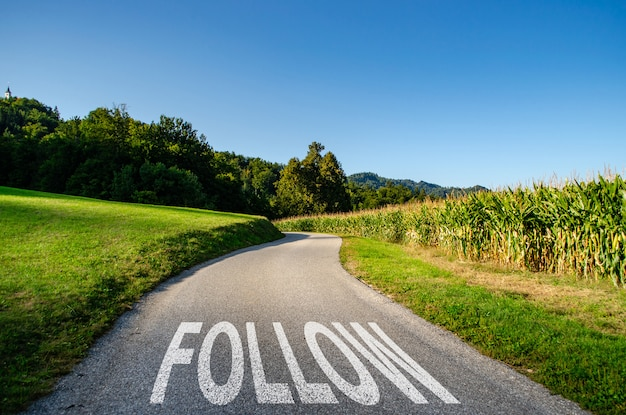 Follow the road as a concept for advancement, direction or journey Premium Photo