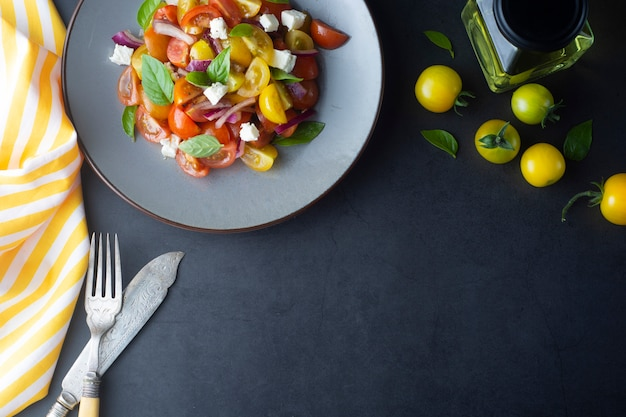 Food, cherry tomatoes and basil salad on in a plate. healthy, summer food. Premium Photo