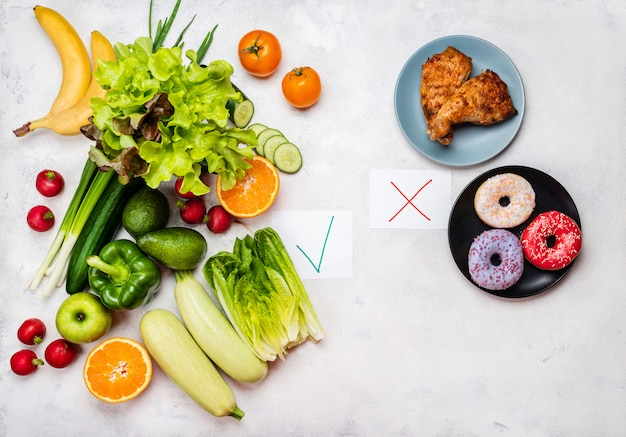 Food choise concept. junk food and diet healthy food. top view. Premium Photo