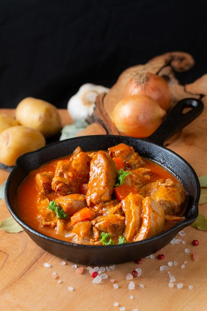 Food concept french classic veal stew marengo de veau in skillet iron cast with copy space Premium Photo