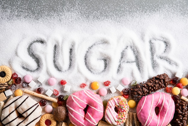 Food containing sugar. mix of sweets concept, body and dental care. Premium Photo