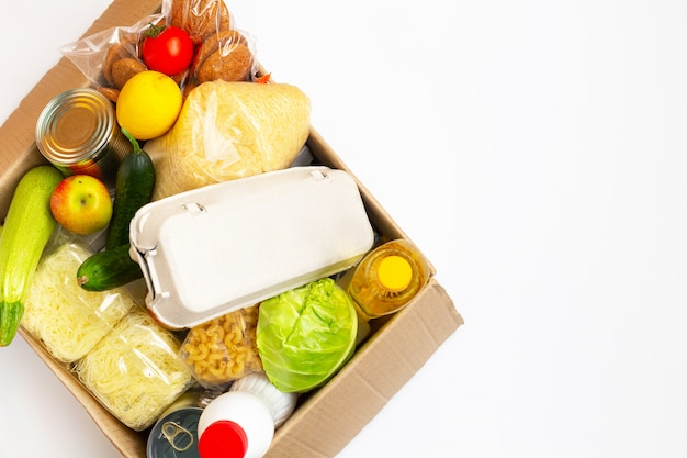 Food donations or food delivery concept in a cardboard box. Premium Photo