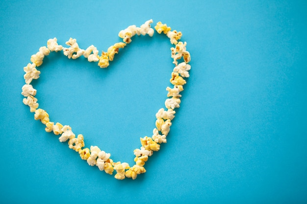 Food. image of the heart forms from popcorn. delicious popcorn. cinema Premium Photo
