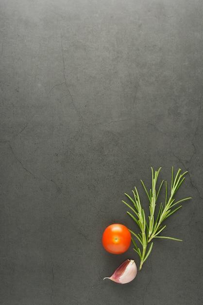 Food mock up rosemary and cherry tomatoes Premium Photo